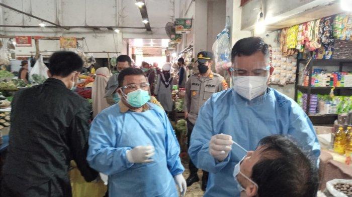 Rapid Tes Massal di Pasar Tiga Orang Reaktif