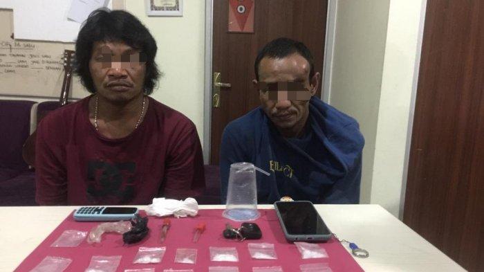 Kedua pelaku penyalahgunaan narkoba jenis sabu di Pangkalpinang diamankan Tim Kalong Satresnarkoba Polres Pangkalpinang, Jumat (30/7/2021)