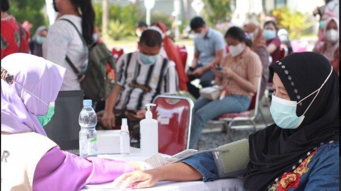 Dukung Program Pemerintah, BI dan OJK Gelar Vaksinasi Massal