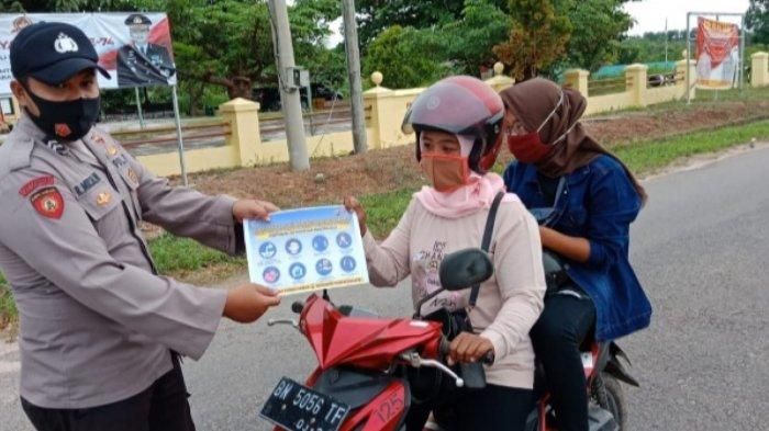 Edukasi Masyarakat untuk Cegah Penyebaran Covid-19,Polsek Lubuk Besar Gencar Lakukan Ops Yustisi