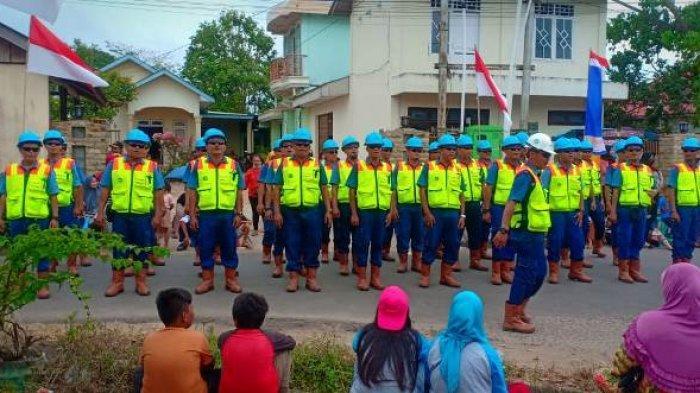 Pasukan Wasprod PT Timah IV Toboali Kenalkan Perlengkapan K3 ke Masyarakat Pada Pawai HUT ke-74 RI