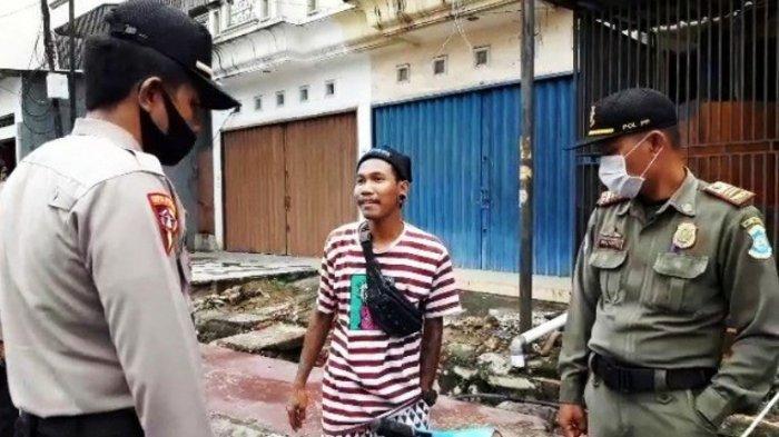 Sat Pol PP Kota Pangkalpinang dan Polres Pangkalpinang, razia masyarakat yang tidak menggunakan masker, di Kota Pangkalpinang, beberapa waktu lalu.