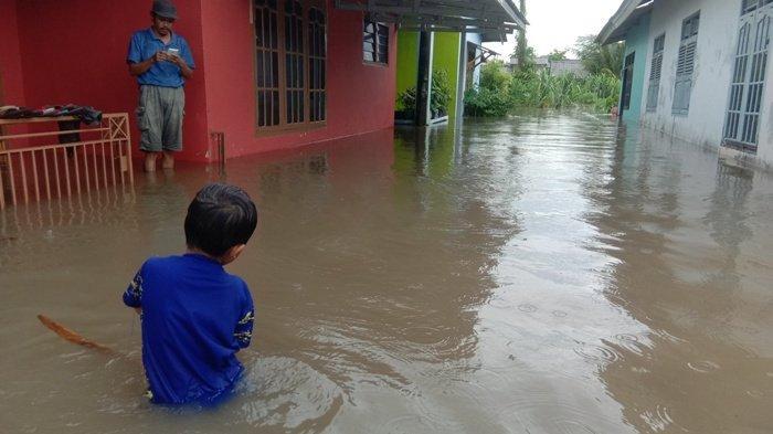 rumah-warga-yang-banjir1.jpg