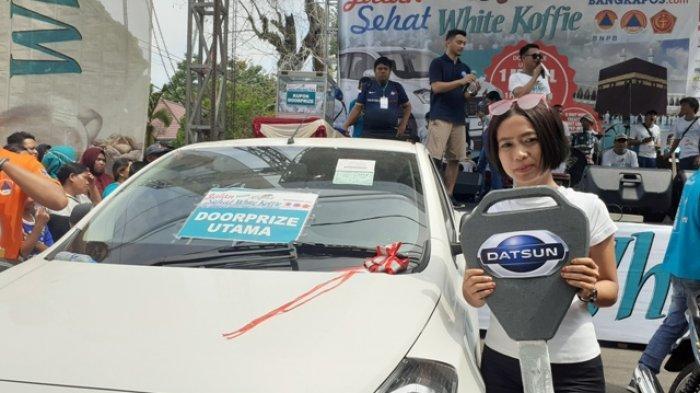 Pegawai Hotel Ini Menangkan Mobil Datsun Go, Hampir Mau Pulang Saat Pembagian Doorprize Jalan Sehat