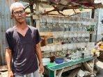 20210413-sumaryadi-43-penjual-ikan-hias-di-depan-makam-belanda.jpg