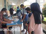 20210708-pendaftaran-ulang-siswa-baru-di-smpn-2-sungailiat-kabupaten-bangka.jpg