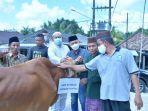 20210718-penyerahan-sapi-kurban-dan-bantuan-kepada-masyarakat.jpg