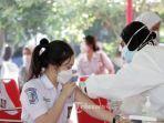20210719-pelajar-sma-n-1-semarang-menerima-suntikan-vaksin-covid-19.jpg