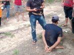 20211021-seorang-pria-diamankan-pihak-kepolisian-di-hutan-sawit-di-kabupaten-bangka.jpg