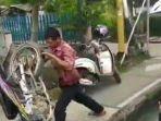 capture-video-viral-seorang-pria-marah-dan-bantin.jpg