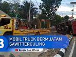 evakuasi-mobil-truck-bermuatan-sawit-terguling-di-jalan-raya-jendral-sudirman-km-5-5.jpg