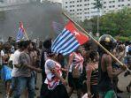 ilustrasi-ratusan-massa-turun-ke-kota-kantor-majelis-rakyat-papua-dibakar.jpg