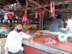 iyan-pedagang-daging-sapi-di-pasar-pangkalpinang.jpg
