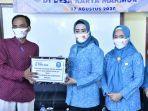 ketua-tp-pkk-kabupaten-bangka-yusmiati-mulkan-meluncurkan-program-gerakan-setengah-miliar-masker.jpg