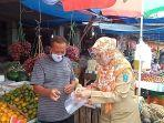 membagikan-masker-dan-face-shield-di-pasar-tradisional-tanjungpandan.jpg