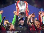 pelatih-liverpool-juergen-klopp-dan-tim-merayakan-kesuksesan-mereka-meraih-gelar-liga-champions.jpg