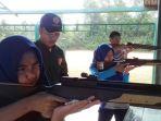 pelatih-saat-memberikan-arahan-kepada-atlet-menembak_20180128_152952.jpg