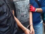 penjahat-ditangkap-diborgol_20170320_081507.jpg