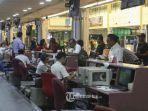 penumpang-antre-checkin-maskapai-lion-air-di-bandara-hang-nadim-batam-selasa-81.jpg