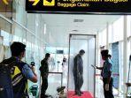 penumpang-bandara-lewat-disinfeksi.jpg