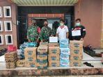 penyerahan-bantuan-untuk-warga-desa-sadai-yang-menjalani-masa-karantina-di-desa-sadai.jpg