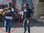 polisi-selamatkan-anak-kecil-ledakan-bom_20180514_114414.jpg