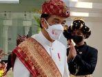presiden-joko-widodo-mengenakan-pakaian-adat-lampung.jpg