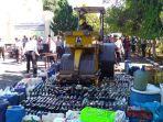 ribuan-liter-miras-tradisional-dan-ribuan-botol-miras-dimusnahkan.jpg