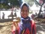ririn-jonathan-saat-memegang-medali-emas-porwil-x-sumatra-2019-di-bengkulu.jpg