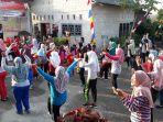 senam-massal-meneriakkan-hut-kemerdekaanke-73-republik-indonesia_20180819_182326.jpg