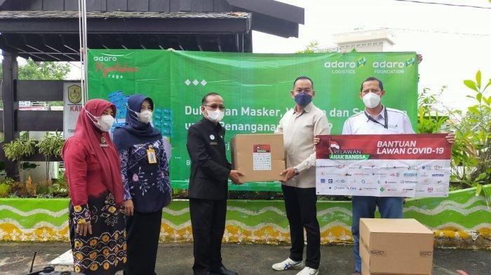 Bantu Masyarakat Isoman, Adaro Logistics Bagikan 4.000 Paket Masker Plus Vitamin