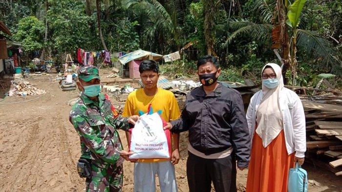 Banjir di Kalsel, TNI dan Polri Distribusikan Paket Bantuan Presiden di Kabupaten HST