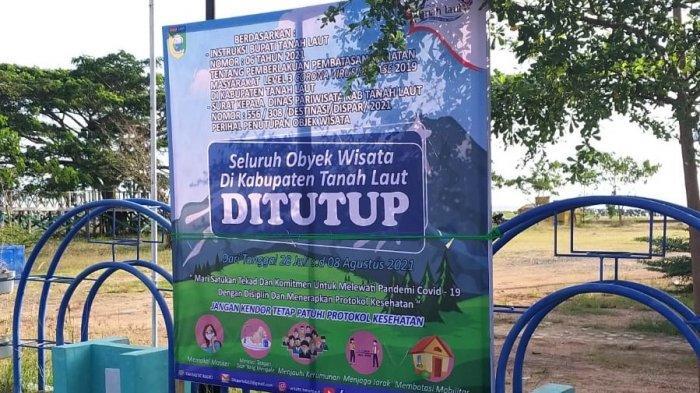 Dispar memajang banner penutupan sementara Pantai Takisung