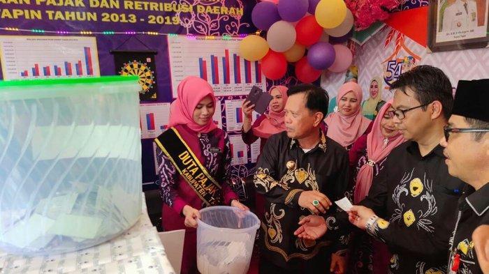 Bank Kalsel Hadiri Peringatan Hari Jadi ke-54 Kabupaten Tapin, Ada Hadiah Bagi Pembayar PBB