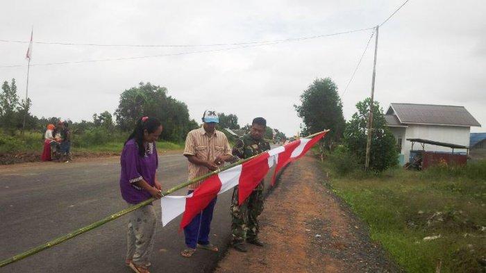 Koramil CLU Sadarkan Warga Desa Terpencil Pasang Bendera