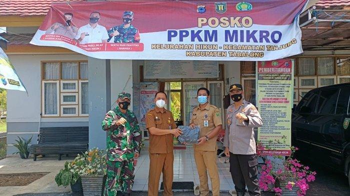 Prokes Ketat Saat Salat Idul Fitri, Masker Dibagikan untuk Warga Hikun Kabupaten Tabalong