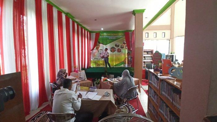 Akmal Bawakan Syair Tentang Pandemi di Ajang di Ajang Gemar Membaca Dinas Perpustakaan Balangan