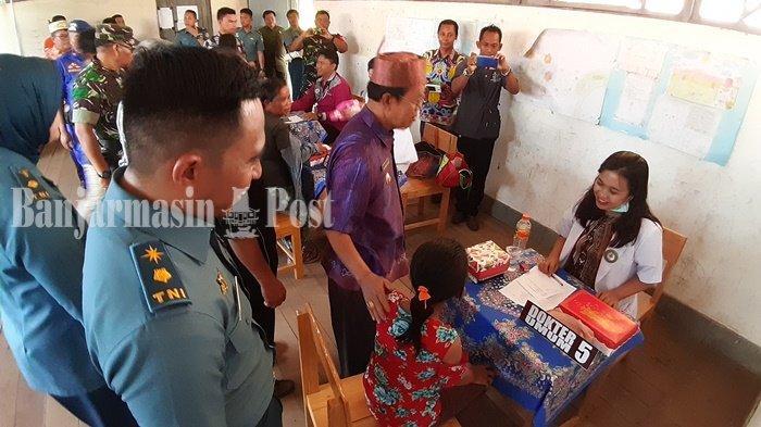 Ratusan Warga Serbu Karya Bakti Kesehatan Gratis Lanal Banjarmasin di Pulau Telo Kapuas