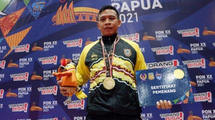 Kalahkan Pegulat Sumbar, Arbainsyah Sumbangkan Emas Perdana untuk Kalsel di PON XX Papua 2021