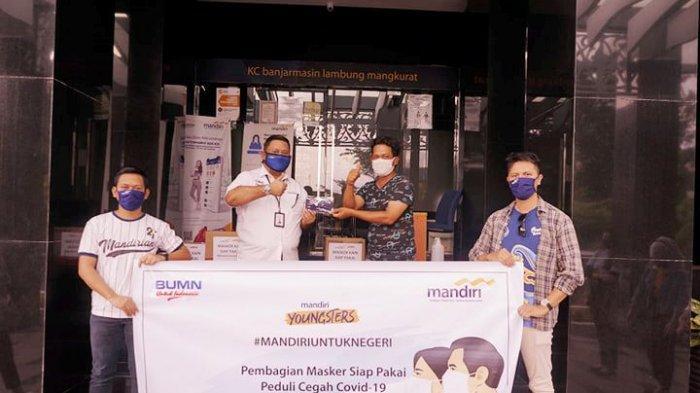 Siaga Corona, Bank Mandiri Bagikan 1.200 Masker ke Warga Banjarmasin