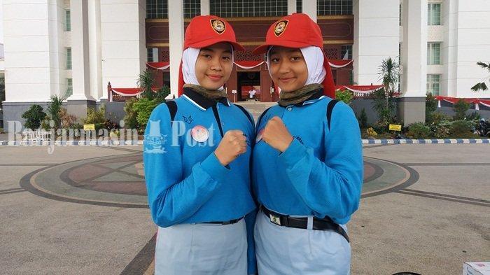 Dua Remaja Cantik Ini Pembawa Baki di Pengibaran dan Penurunan Bendera 17 Agustus di Pemprov Kalsel
