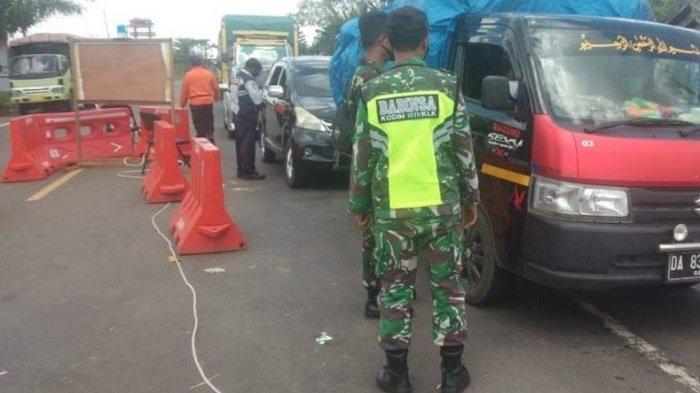 Penjagaan pada Pos Terpadu Peniadaan Mudik di Kapuas, Begini SOP Pemeriksaan Pemudik