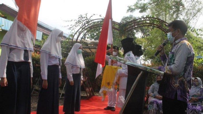 Lulus 100 Persen, 24 Siswa Terbaik di SMPN 14 Banjarmasin Wakili 238 Siswa Saat Pengukuhan Virtual