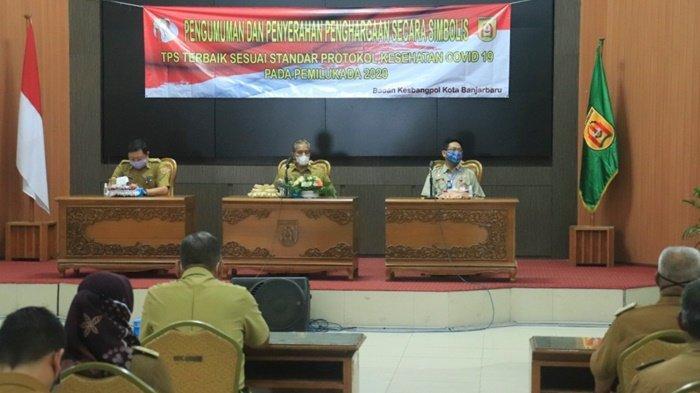 Pengumuman dan penyerahan TPS terbaik Pilkada 2020 di Pemko Banjarbaru.