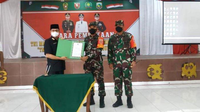 Sekdakab Kotabaru H Said Akhmad menunjukan kesepakatan kegiatan program TMMD