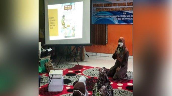Tim Fakultas Kedokteran Universitas Lambung Mangkurat (FK ULM) saat di Puskesmas Martapura Barat, Kabupaten Banjar, Provinsi Kalimantan Selatan.