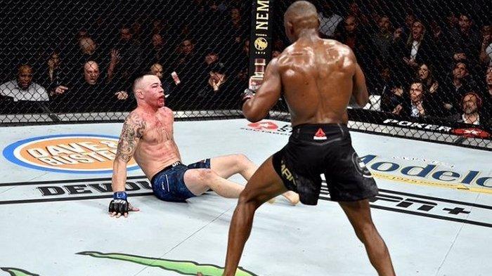 Wajah Colby Covington berdarah-darah saat dikanvaskan Kamaru Usman pada ronde kelima partai utama UFC 245 di T-Mobile Arena, Las Vegas, Nevada, pada Sabtu (14/12/2019).