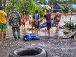 2-suasana-warga-melakukan-pencarian-korban-banjir-meninggal-dunia-sahidun.jpg