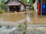 20210113_siti-bulkis_banjir-melanda-desa-pingaran-astanbul-kabupaten-ba.jpg
