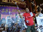 ade-iskandar-roni-memenangkan-hadiah-satu-juta-dolar-singapura-atau-setara-rp-93-miliar-lebih_20170117_181920.jpg